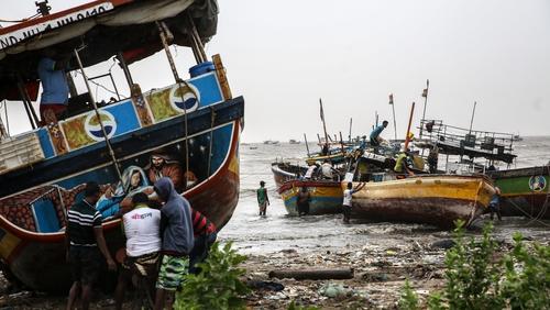 Fisherman in village near Mumbai anchor their boats as Cyclone Nisarga approaches
