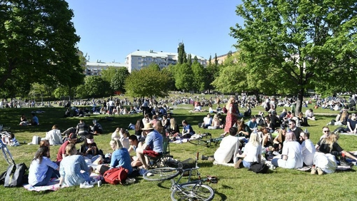 People enjoy the sunny weather in Tantolunden park in Stockholm