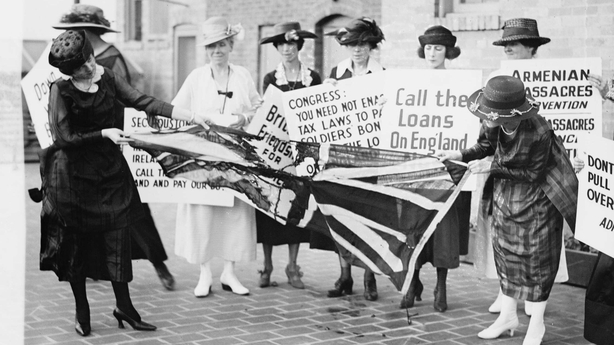 A group of women burning and destroying a union flag in Washington DC