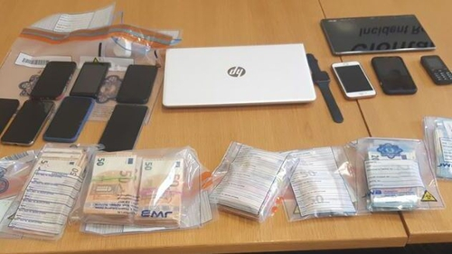 Cash and phones were among the items seized during the searches in Dublin