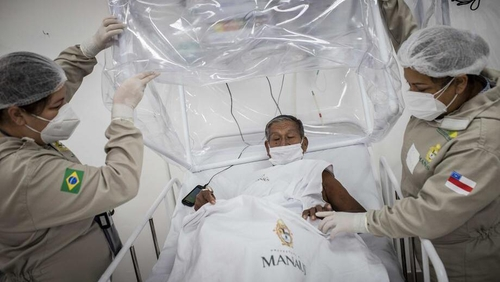 An elderly man is treated for Covid-19 at a hospital in Manaus, Brazil