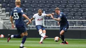 Kane (c) gets a shot off during a training game at Tottenham Hotspur Stadium