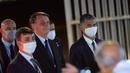 President Jair Bolsonaro speaks with supporters at Alvorada Palace