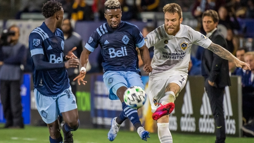 Aleksandar Katai (right) delivers a cross in the LA Galaxy's encounter with the Vancouver Whitecaps in March