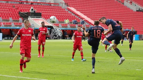 Robert Lewandowski heads home Bayern's fourth