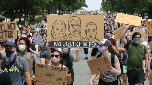 Demonstrators marching along Constitution Avenue in Washington DC today