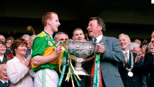 Hassett accepting the Sam Maguire Cup from GAA President Joe McDonagh