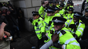 Police clash with protesters during a Black Lives Matter march in London today