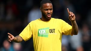 Raheem Sterling wearing a Kick It Out anti-racism shirt in 2019