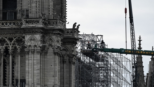 Workers dismantling the scaffolding at the Notre-Dame Cathedral in Paris