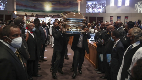 Pallbearers carrying the casket of George Floyd out of the Fountain of Praise Church following the funeral