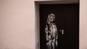 The artwork by street artist Banksy on a side street to the Bataclan concert hall in June 2018