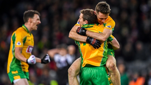 Corofin players celebrate their All-Ireland club football title earlier this year