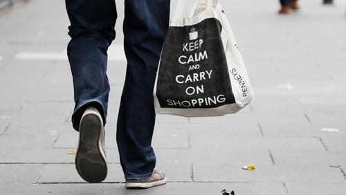 A man carries a shopping bag in Dublin