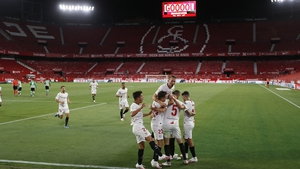 Sevilla players celebrate after Lucas Ocampos gave the hosts the lead in El Gran Derbi