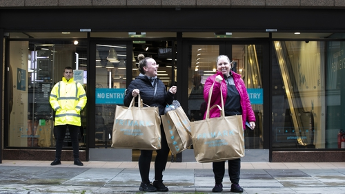 Michelle and Lauren O'Neill from Dublin with their Penneys Bags outside the store on Dublin's O'Connell Street