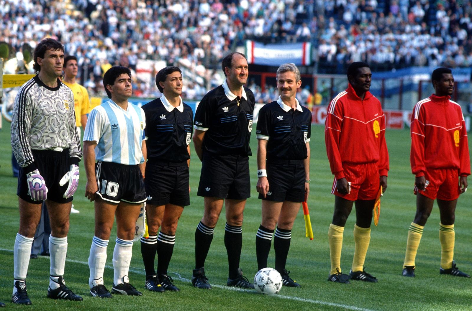 Image - Nery Pumpido, Diego Maradona of Argentina, assistant referee Vincent Mauro, referee Michael Vautrot, assistant referee Michal Listkiewicz and Stephen Tataw of Cameroon