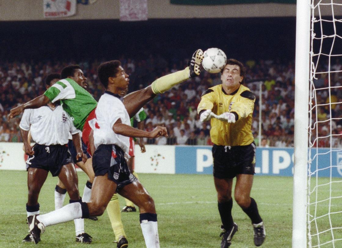 Image - Omam-Biyik (L) tries to force the ball past English goalkeeper Peter Shilton