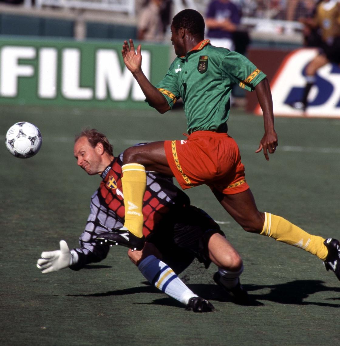 Image - Biyik lifts the ball over Thomas Ravelli against Sweden