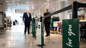Made to measure: British prime minister Boris Johnson in a Marks & Spencer store in London in June