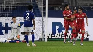 Leverkusen's Kevin Volland and Paulinho (R)celebrate the equaliser
