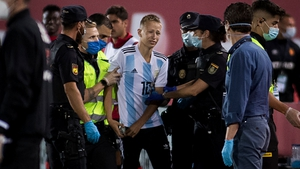The Real Mallorca-Barcelona interloper is escorted away from the field of play