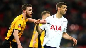 Mark O'Brien (L) marks Fernando Llorente of Tottenham Hotspur in 2018