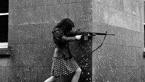 A woman IRA volunteer on active service in west Belfast with an AR18 assault rifle. Photo: Colman Doyle Collection/National Library of Ireland
