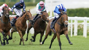 Jockey Jim Crowley rides Battaash (R) to victory in The King's Stand Stakes