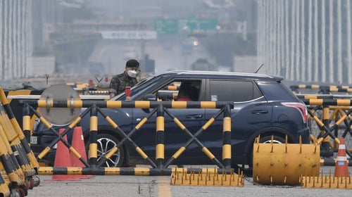 A South Korean soldier at a checkpoint on the road leading to North Korea's Kaesong joint industrial complex, near the Demilitarized Zone