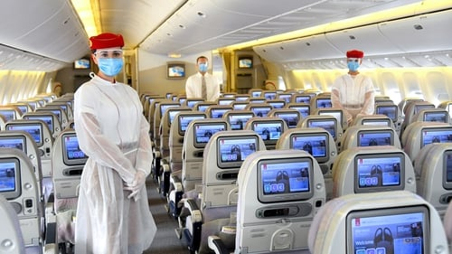 Emirates cabin crew are wearing PPE on flights