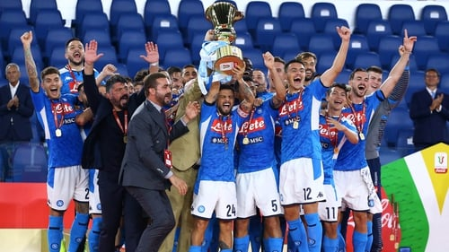 Napoli players celebrate with the trophy