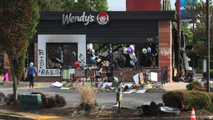 People visit the Wendy's restaurant outside which Rayshard Brooks was shot dead