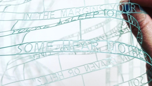 Poetry Net (I) is a poem cut out from recycled translucent plastic film, transforming it into lace-like structure of text reminiscent of nylon fishing nets