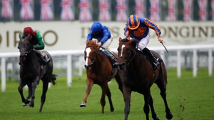 Battleground ridden by Ryan Moore (right) on their way to winning the Chesham