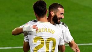 Marco Asensio (L) celebrates his goal with Karim Benzema