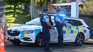 Police are still searching for two suspects after the fatal shooting of an officer in Auckland