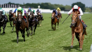 Golden Horde en route to victory in the Ascot Group One