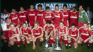 Liverpool FC pose with the league title after being crowned 1989/90 league champions