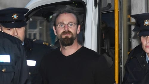 Stephen Silver arriving in court accompanied by gardaí