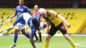 Wilfred Ndidi of Leicester City tangles with Watford's Will Hughes