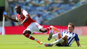 Nicolas Pepe of Arsenal is challenged by Brighton's Dan Burn