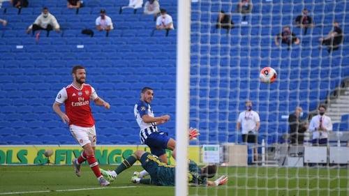 Brighton's French striker Neal Maupay (C) scores the winner