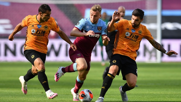 West Ham United's Jarrod Bowen (C) is sandwiched by Wolves' Jonny Otto (L) and Ruben Neves