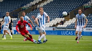 Anthony Pilkington scores Wigan's second goal in the win over Sheffield Wednesday