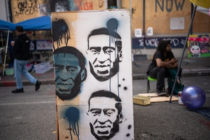Images of George Floyd are seen in the 'police-free' autonomous zone in Seattle