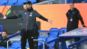 Jurgen Klopp looks on as Everton coach Duncan Ferguson keeps his social distance from the Liverpool boss