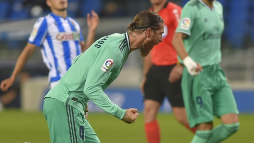 Sergio Ramos celebrates as he scores from the spot