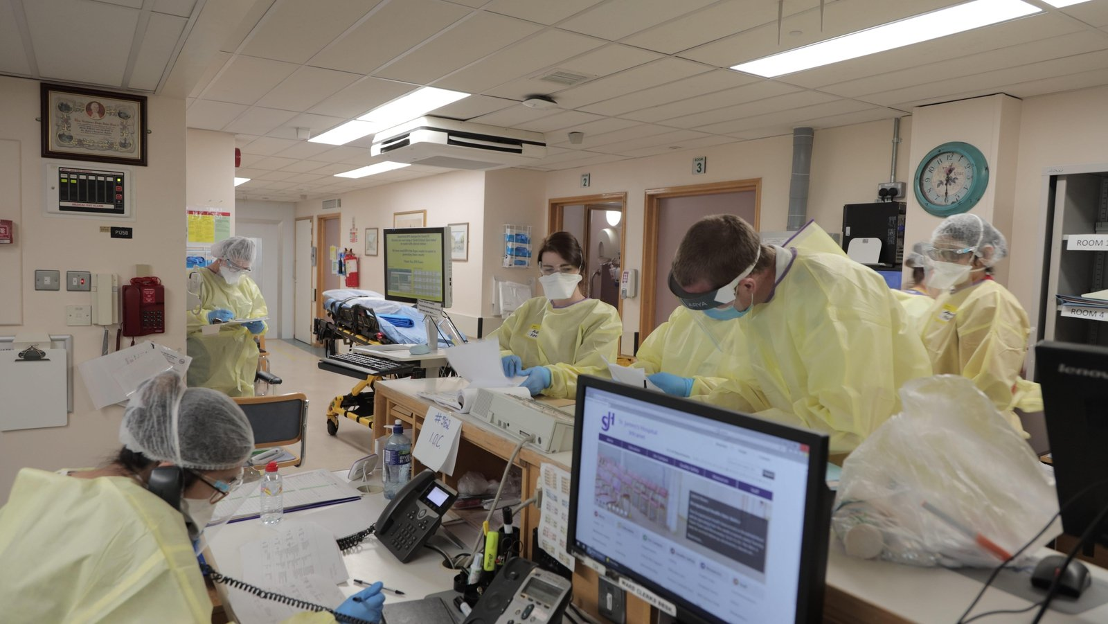 Image - Medical staff busy at work in one of the hospital's Covid positive wards