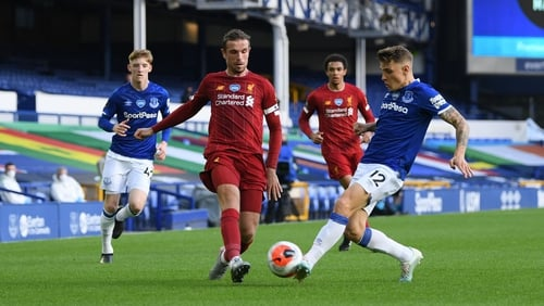 Everton's Lucas Digne and Liverpool's Jordan Henderson battle for the ball in the Merseyside derby at Goodison Park in June